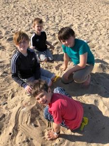 Boys playing in the sand in Llandudno