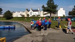 Boys launching raft in Isle of Man